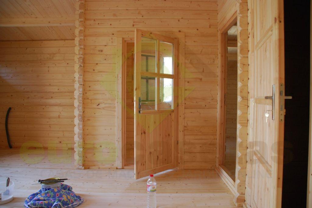 Montaje casa de madera dani en manresa eurocasetas for Montaje tejados de madera